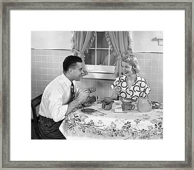 Husband And Wife Eating Breakfast Framed Print by H. Armstrong Roberts/ClassicStock