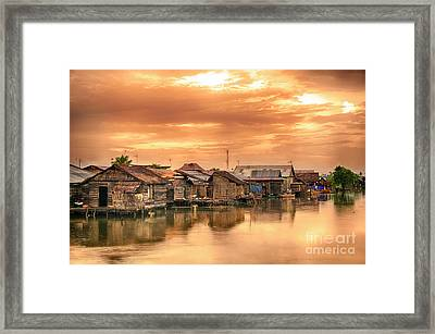 Framed Print featuring the photograph Huts On Water by Charuhas Images