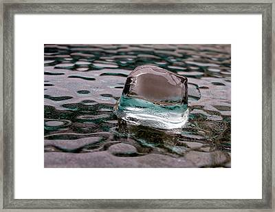 Framed Print featuring the photograph Ice Cube On Glass V1 by Rico Besserdich