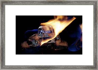 Framed Print featuring the photograph Ice Cubes Under Fire by Rico Besserdich
