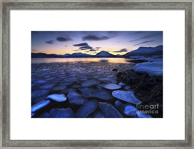 Ice Flakes Drifting Against The Sunset Framed Print