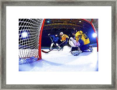 Ice Hockey Battle Through The Cage Framed Print by Elaine Plesser