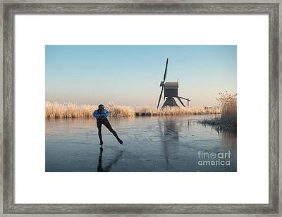 Ice Skating Past Frosted Reeds And A Windmill Framed Print