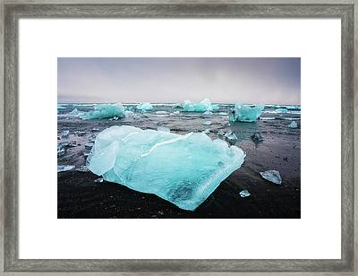 Framed Print featuring the photograph Iceberg Pieces In Iceland Jokulsarlon by Matthias Hauser