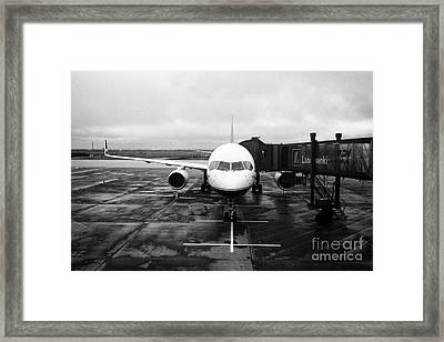 icelandair aircraft on stand at departures gate Keflavik airport Iceland Framed Print by Joe Fox