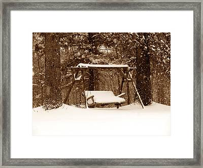 Swing With Snow Framed Print by John Myers