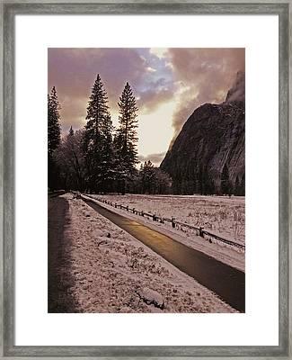 In Between Snow Falls Framed Print