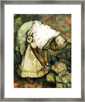 In Her Garden Framed Print