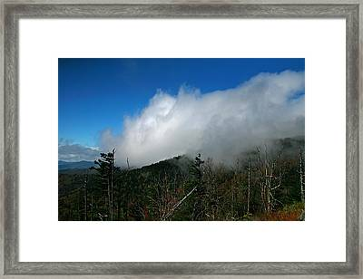 In The Clouds Framed Print by James Jones