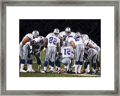 In The Huddle Framed Print