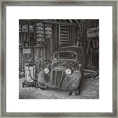 In The Old Garage Framed Print