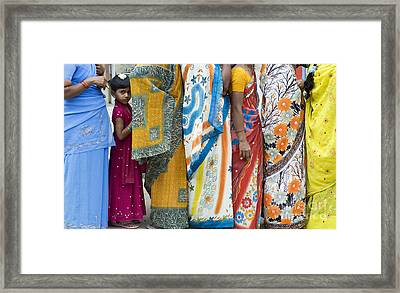 In The Queue Framed Print by Tim Gainey