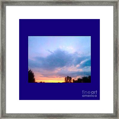 In The Sky Above And Below Framed Print