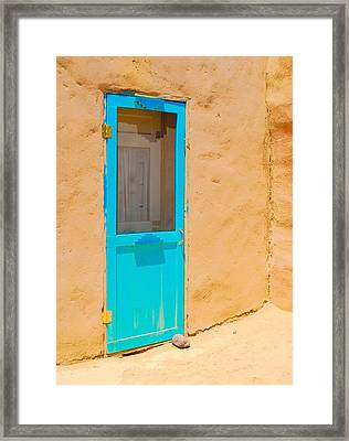 In Through The Blue Door Framed Print
