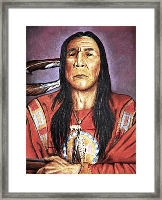 Indian With Rifle Framed Print by Martin Howard