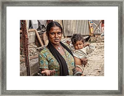 Indian Woman With A Child Framed Print by Artur Pirant
