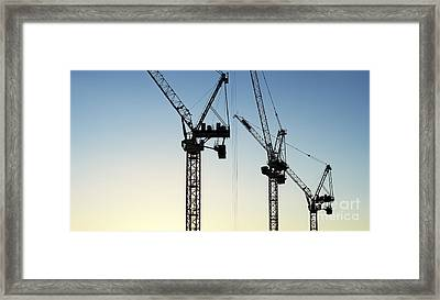 Industrial Cranes Silhouette Framed Print by Tim Gainey