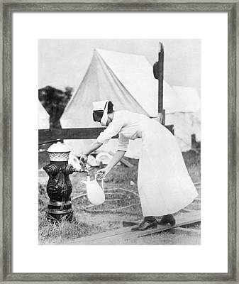 Influenza Outbreak Nurse Framed Print by Underwood Archives