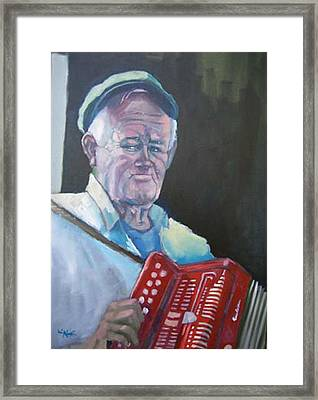 Inis Mor Accordian Player Framed Print by Kevin McKrell