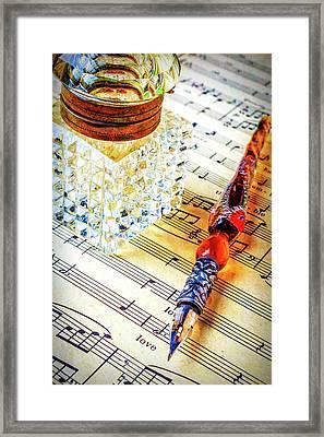 Ink Well On Sheet Music Framed Print