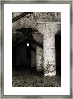 Inside Empty Dark Building With Light Bulbs Lit Framed Print by Gothicrow Images