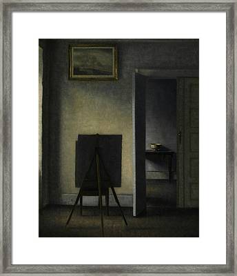 Interior With The Artist's Easel Framed Print by Vilhelm Hammershoi