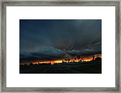 Intersection At Sunset Framed Print by Toni Hopper