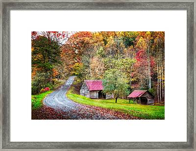 Into Autumn Framed Print by Debra and Dave Vanderlaan