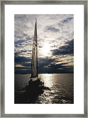 Into The Sunset Framed Print by Tom Dowd