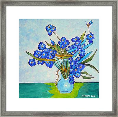 Iris In Blue Vase Framed Print
