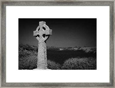 Irish Celtic Cross Overlooking Lake Framed Print by Joe Fox