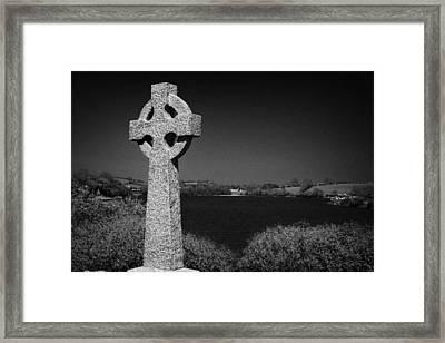 Irish Celtic Cross Overlooking Lake Framed Print by Joe Fox