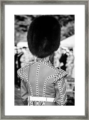 irish guards guardsman in full dress uniform with bearskin hat from the rear Northern Ireland Framed Print by Joe Fox
