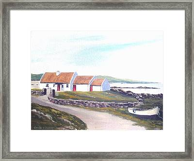 Irish Thatched Cottage Framed Print by Cathal O malley