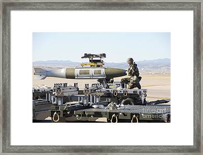 Irman Assists In Lowering A Guided Bomb Framed Print by Stocktrek Images