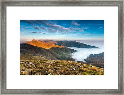 Island In The Lake Of Clouds Framed Print by Evgeni Dinev