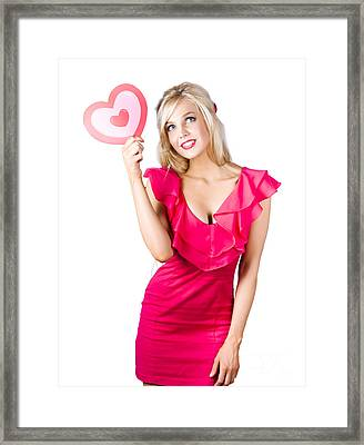 Isolated Blond Girl Holding Love Heart Sign Framed Print by Jorgo Photography - Wall Art Gallery