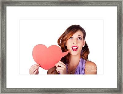 Isolated Girl Talking Through Heart Speech Bubble Framed Print by Jorgo Photography - Wall Art Gallery