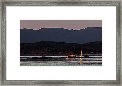 Isolated Lighthouse Framed Print