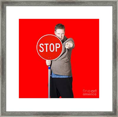 Isolated Man Holding Red Traffic Stop Sign Framed Print