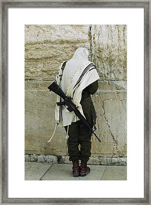 Israeli Soldier With Rifle Praying Framed Print by Paul Chesley