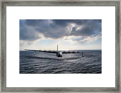 It Does Fly Framed Print by Peter Chilelli