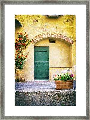 Framed Print featuring the photograph Italian Facade With Geraniums by Silvia Ganora