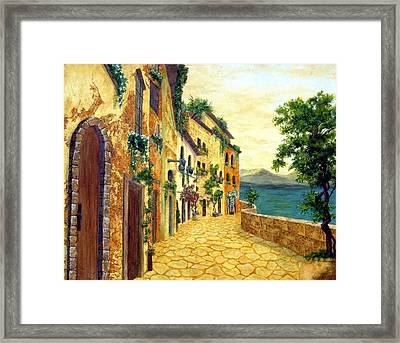 Italy's Hues Framed Print by Leslie Rhoades