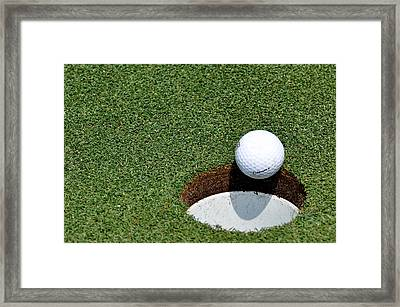It's In The Hole Framed Print