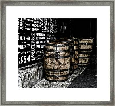 Jack Daniel's Tennessee Whiskey Barrels Framed Print by Paul Brennan