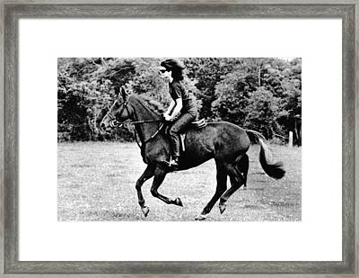 Jacqueline Kennedy, Riding A Horse Framed Print by Everett