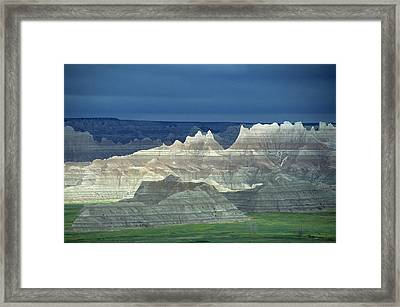 Jagged Badlands Formations, Spotlit On A Gloomy Day Framed Print by Altrendo Nature