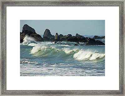 Jagged Rocks And Breaking Waves Framed Print