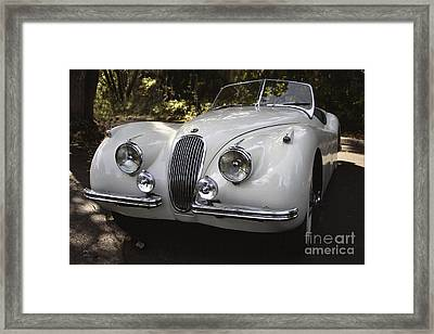 Jaguar Xk-120 Framed Print by Curt Johnson